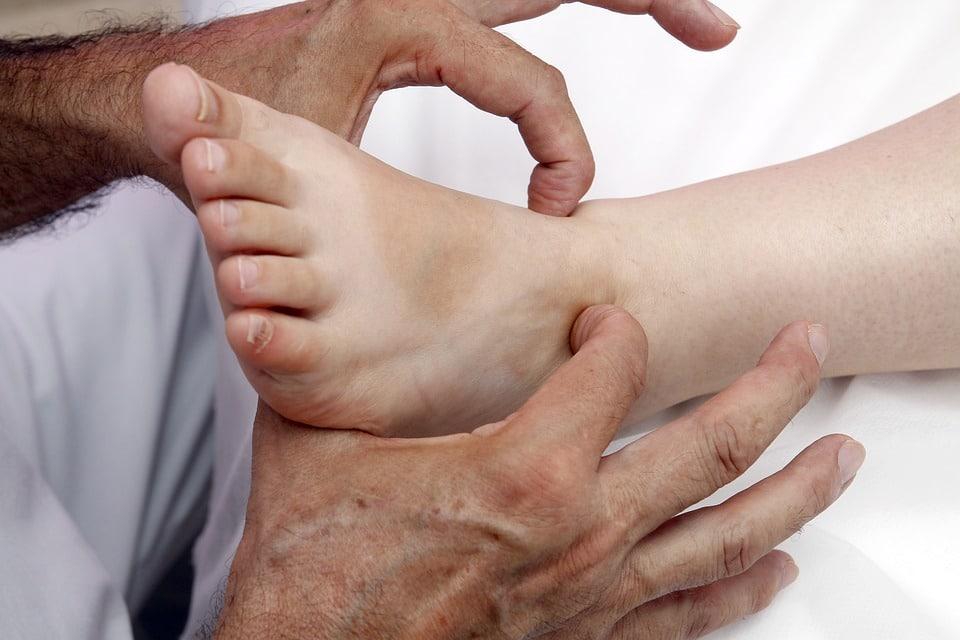Hands on foot