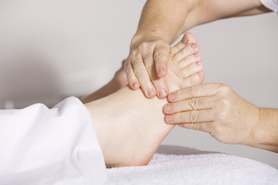 hands doing foot massage