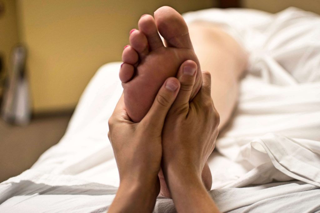 A person gets a foot zoning massage