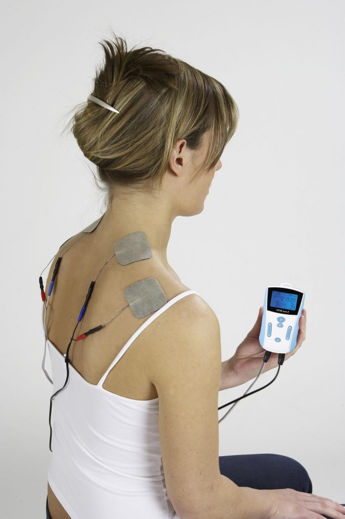 A woman using the best Tens Unit on Amazon